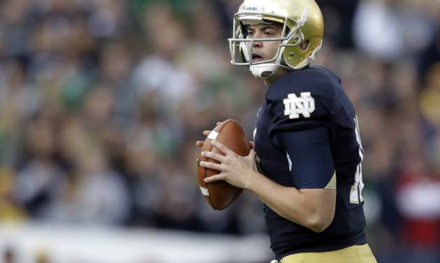 Notre Dame quarterback Tommy Rees drops back to pass against Brigham Young during the first half of an NCAA college football game in South Bend, Ind., Saturday, Oct. 20, 2012. (AP Photo/Michael Conroy)