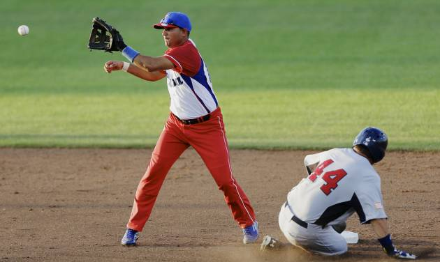 United States' Kyle Schwarber (44) steals second base against Cuba shortstop Yordan Manduley in the fourth inning of an exhibition baseball game in Papillion, Neb., Friday, July 19, 2013. (AP Photo/Nati Harnik)