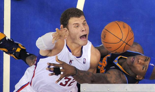 Los Angeles Clippers forward Blake Griffin, left, puts up a shot as Denver Nuggets forward Al Harrington defends during the first half of an NBA basketball game, Thursday, Feb. 2, 2012, in Los Angeles. (AP Photo/Mark J. Terrill)