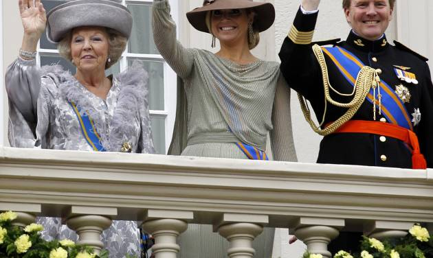 FILE - In this Sept. 20, 2011 file photo, Dutch Queen Beatrix, left, Crown Prince Willem Alexander, right, and his wife Princess Maxima, center, wave to wellwishers from the balcony of Royal Palace Noordeinde after the Queen officially opened the new parliamentary year in The Hague, Netherlands. Queen Beatrix announced she is to abdicate in favor of Crown Prince Willem Alexander during a nationally televised speech Monday, Jan. 28, 2013. Beatrix, who turns 75 on Thursday, has ruled the nation of 16 million for more than 32 years and would be succeeded by her eldest son, Crown Prince Willem-Alexander. (AP Photo/Bas Czerwinski, File)