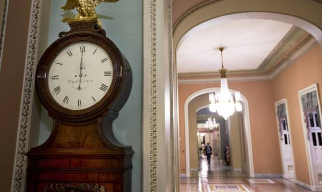 """FILE - In this Tuesday, Jan. 1, 2013, file photo, the Ohio Clock strikes midnight as the Senate continues to work on the fiscal cliff, on Capitol Hill in Washington. The deal in Congress that stopped the country from going over the """"fiscal cliff"""" removed one layer of uncertainty for small business owners who now have a sense of what their income taxes will be in 2013, but big issues still remain for them to worry about. (AP Photo/Alex Brandon, File)"""