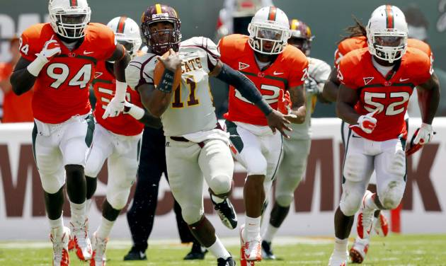 Bethune-Cookman quarterback Brodrick Waters (11) scrambles with the ball against Miami in the first half of an NCAA college football game, Saturday Sept. 15, 2012, in Miami. (AP Photo/Wilfredo Lee)