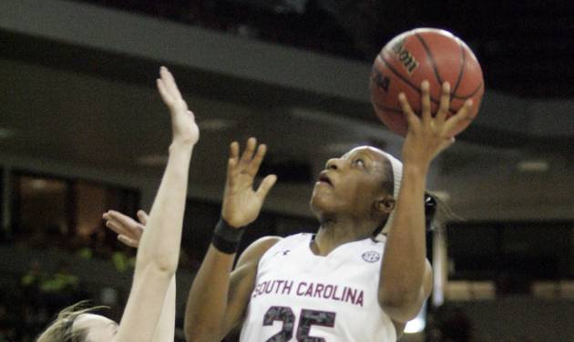 South Carolina's Tiffany Mitchell (25) drives for the basket as Missouri's Joday Frericks tries to block during the first half of an NCAA college basketball game on Sunday, Feb. 2, 2014, in Columbia, S.C. South Carolina won 78-62. (AP Photo/Mary Ann Chastain)