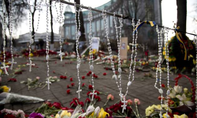 Rosary beads hang on a barricade in Kiev's Independence Square, the epicenter of the country's current unrest, Ukraine, Monday, Feb. 24, 2014. Ukraine's acting government issued a warrant Monday for the arrest of President Viktor Yanukovych, last reportedly seen in the pro-Russian Black Sea peninsula of Crimea, accusing him of mass crimes against protesters who stood up for months against his rule. (AP Photo/Darko Bandic)