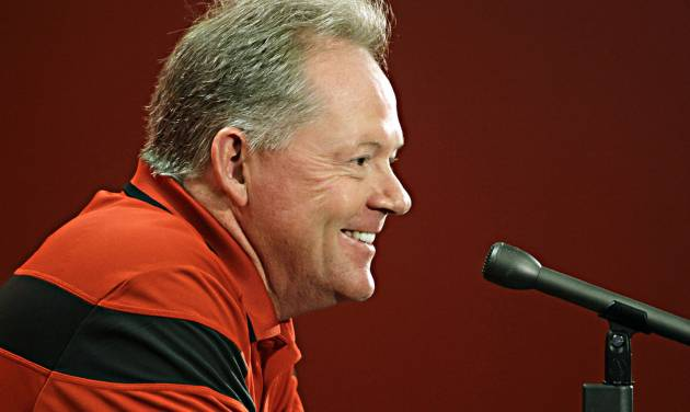 Louisville football coach Bobby Petrino answers questions about his NCAA college football team during a media day news conference in Louisville, Ky., Saturday, Aug. 9, 2014.  (AP Photo/Garry Jones)