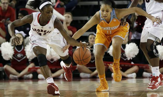 FILE - In this Jan. 5, 2014 file photo, Georgia guard Erika Ford, left, and Tennessee forward Cierra Burdick (11) chase down a loose ball in the first half of an NCAA college basketball game in Athens, Ga. Georgia has dropped out of the Top 25 after a 0-4 start in the SEC. (AP Photo/John Bazemore, File)