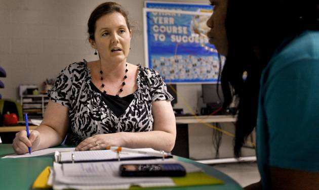 Literature teacher Shelly Campbell works with student Dacember Traylor at John Marshall High School. Campbell was named the Oklahoma City Public Schools Teacher of the Year last year.  CDL1 - CHRIS LANDSBERGER