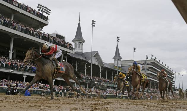 Joel Rosario rides Orb to victory during the 139th Kentucky Derby at Churchill Downs Saturday, May 4, 2013, in Louisville, Ky. (AP Photo/David J. Phillip)