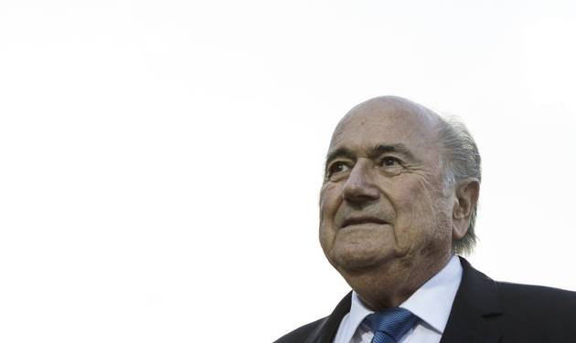 FIFA President Sepp Blatter walks beside the pitch before Canada's game against Ghana in 2014 FIFA U-20 women's World Cup action in Toronto on Tuesday Aug.5, 2014.(AP Photo/The Canadian Press, Chris Young)