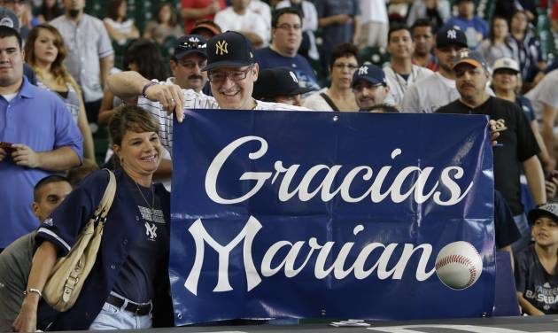 New York Yankees fans show their appreciation for retiring closer Mariano Rivera before a baseball game against the Houston Astros Sunday, Sept. 29, 2013, in Houston. (AP Photo/Richard Carson)