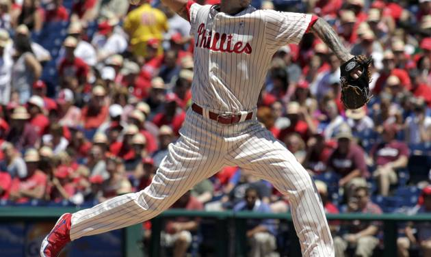 Philadelphia Phillies starting pitcher A.J. Burnett throws against the Chicago Cubs in the first inning of a   baseball game Sunday, June 15, 2014, in Philadelphia. (AP Photo/H. Rumph Jr)
