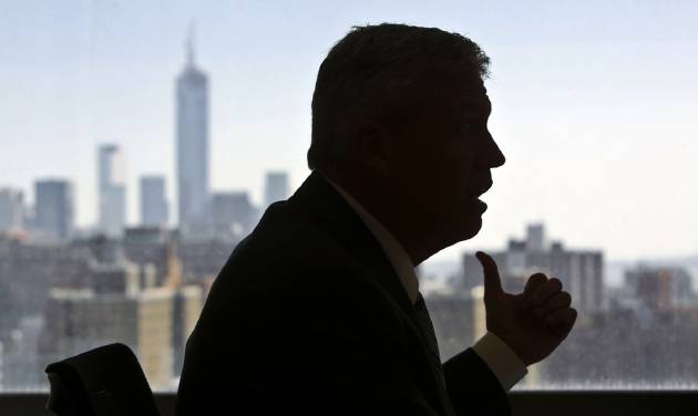 New York Jets coach Rex Ryan is silhouetted against the city skyline as he speaks during an interview on Friday, May 3, 2013 in New York.  (AP Photo/Bebeto Matthews)