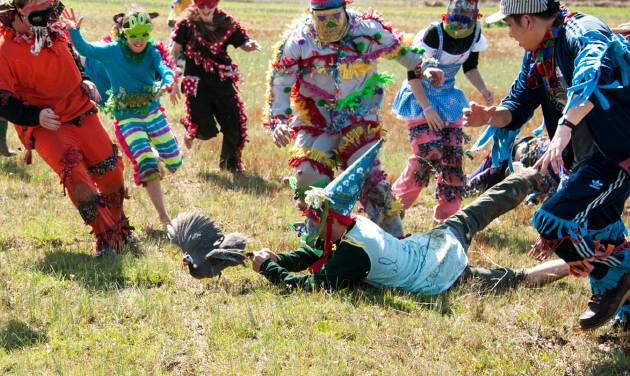 This February 2012 image provided by St. Landry Parish Tourist Commission shows young participants in a guinea hen chase in Eunice, La., a Mardi Gras season tradition in Louisiana's Cajun country. The region has its own family-oriented Mardi Gras customs rooted in rural traditions, very different from the Mardi Gras parties and parades of New Orleans. (AP Photo/St. Landry Parish Tourist Commission, David Simpson)
