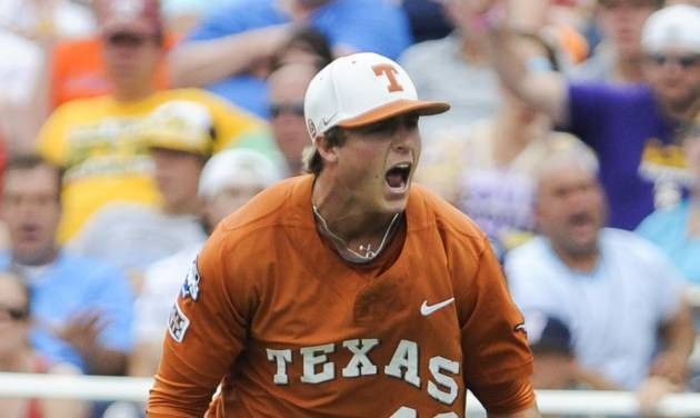 Texas first baseman Kacy Clemens (42) celebrates after taking out UC Irvine's Connor Spencer (33) following a throw from Texas shortstop C.J Hinojosa in the third inning of an NCAA baseball College World Series game in Omaha, Neb., Saturday, June 14, 2014. (AP Photo/Dave Weaver)