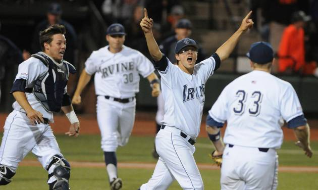 UC Irvine's Elliot Surrey, second from right celebrates, as catcher Jerry McClanahan, first baseman Connor Spencer (33) and Adam Alcantara (30) celebrate an NCAA college baseball regional tournament game against Oregon State in Corvallis, Ore., Monday, June 2, 2014. (AP Photo/Mark Ylen)