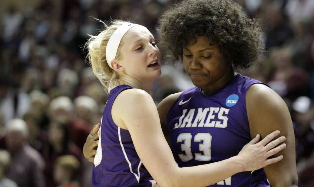James Madison's Nikki Newman hugs teammate Lauren Okafor (33) after the team's 85-69 loss toTexas A&M in an NCAA women's college basketball tournament second-round game, Tuesday, March 25, 2014, in College Station, Texas. (AP Photo/Patric Schneider)