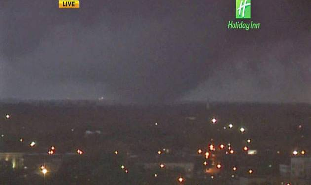 In this image from video provided by WALA-TV in Mobile, Ala. a tornado touches down in Mobile on Tuesday, Dec. 25, 2012. The tornado hit some areas of downtown Mobile Tuesday, causing severe damage in the area before moving north, officials said. (AP Photo/WALA-TV) MANDATORY CREDIT: WALA-TV