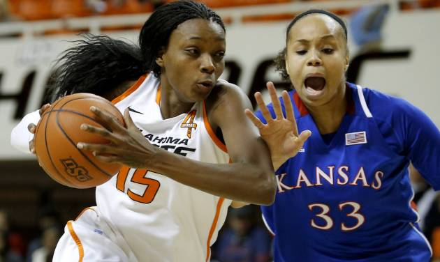 Oklahoma State's Toni Young (15) goes past Kansas' Tania Jackson (33) during a women's college basketball game between Oklahoma State University (OSU) and Kansas at Gallagher-Iba Arena in Stillwater, Okla., Tuesday, Jan. 8, 2013. Oklahoma State won 76-59. Photo by Bryan Terry, The Oklahoman