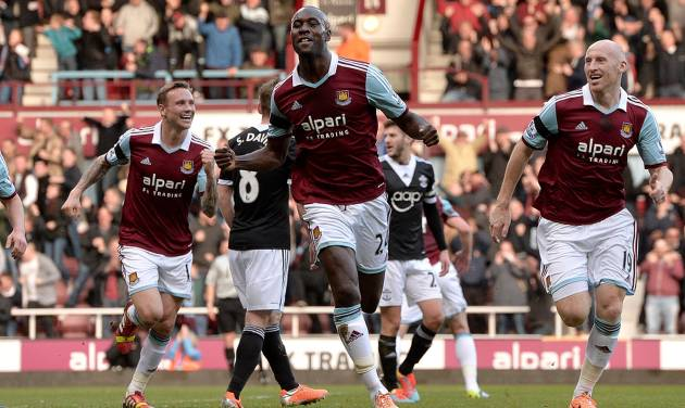 West Ham United's Carlton Cole, centre,  celebrates scoring his side's second goal of the game,  during the English Premier League match against Southampton, at Upton Park, London, Saturday Feb.  22, 2014. (AP Photo/PA, Anthony Devlin) UNITED KINGDOM OUT: NO SALES: NO ARCHIVE