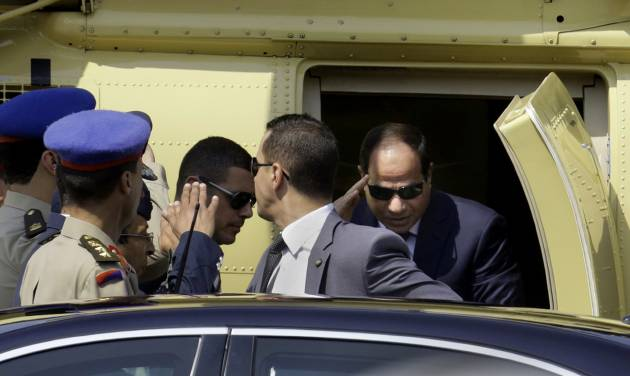 Egyptian President-elect Abdel-Fattah el-Sissi gets out of a military helicopter as he arrives at the Supreme Constitutional Court, to take the oath of office in Cairo, Egypt, Sunday, June 8, 2014. Egypt's former army chief El-Sissi was sworn in on Sunday as president for a four-year term, taking the reins of power in a nation roiled since 2011 by deadly unrest and economic woes. (AP Photo/Amr Nabil)