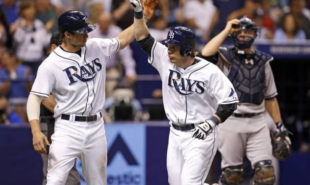 Tampa Bay Rays' Ryan Hanigan, center, is congratulated on his two-run home run by teammate Wil Myers in front of New York Yankees catcher Brian McCann during the fourth inning of a baseball game Saturday, April 19, 2014, in St. Petersburg, Fla. (AP Photo/Mike Carlson)