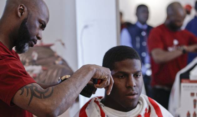 This May 6, 2014 photo shows NFL Draft prospect Kony Ealy, a defensive end from Missouri, getting a haircut during the 5th Annual NFL Pre-Draft Gifting & Style Suite at the Sean John showroom in New York. Ealy is among dozens of prospects on the  National Football League's annual draft, with 32 players per round and seven rounds, beginning Thursday night at Radio City. Ealy is projected to go late in the first round. (AP Photo/Frank Franklin II)