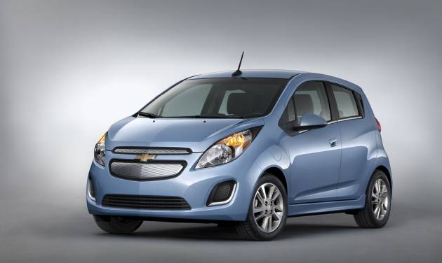 HOLD FOR RELEASE UNTIL 12:01AM TUESDAY, NOV. 26, 2012-This undated image provided by General Motors shows the 2014 Chevrolet Spark EV, which will be unveiled at the 2012 Los Angles Auto Show during the week of Nov. 26, 2012. The five-door urban mini car is priced at under $25,000 with tax incentives. (AP Photo/General Motors)