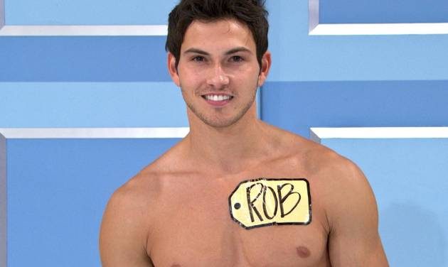 """This undated image from video shows Rob Wilson, of Boston, who was chosen in an online competition to be the first male model on the popular daytime game show, """"The Price is Right."""" Wilson begins his week-long stint alongside the ladies on Oct. 15. Hosted by Drew Carey, """"The Price Is Right"""" airs weekdays at 11 a.m. Eastern time. (AP Photo/CBS)"""