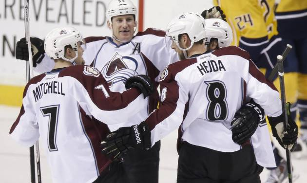 Colorado Avalanche defenseman Jan Hejda (8), of the Czech Republic, celebrates with John Mitchell (7) and Cody McLeod (55) after Hejda scored against the Nashville Predators in the first period of an NHL hockey game, Saturday, Jan. 18, 2014, in Nashville, Tenn. (AP Photo/Mark Humphrey)