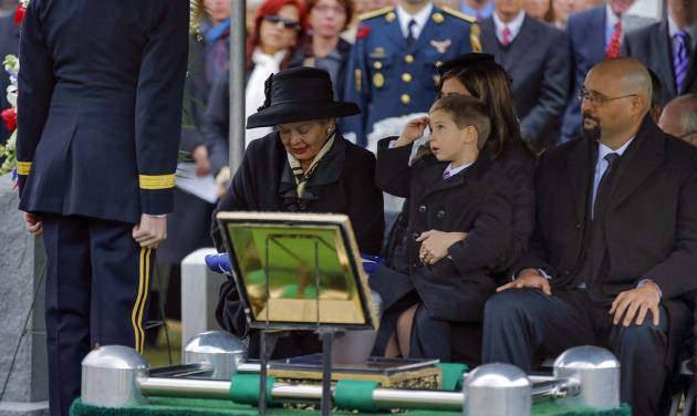 Max Karmazyn, center, sitting next to his grandmother Brenda Schwarzkopf, left, salutes during the burial of his late grandfather, Gen. Norman Schwarzkopf,  at the United States Military Academy on Thursday, Feb. 28, 2013, in West Point, N.Y. Schwarzkopf was 78 when he died of complications from pneumonia on Dec. 27 in Tampa. (AP Photo/Philip Kamrass)