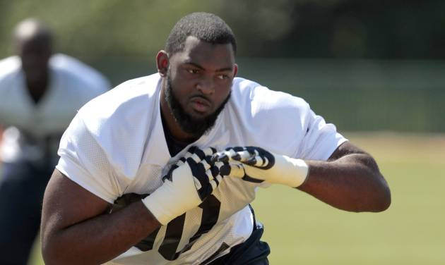 St. Louis Rams defensive tackle Michael Brockers takes part in a drill during NFL football practice, Wednesday, May 16, 2012, at the team's training facility in St. Louis. (AP Photo/Jeff Roberson)