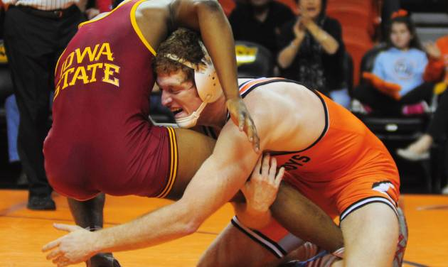 Oklahoma State 184-pound wrestler Nolan Boyd takes down Iowa State's Boaz Beard at a wrestling dual between Oklahoma State and Iowa State at Gallagher Iba Arena in Stillwater on January 24, 2014. Oklahoma State defeated Iowa State 29-3. Photo by KT King/For the Oklahoman