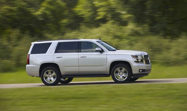 This undated product image provided by Chevrolet shows the 2015 Chevrolet Tahoe. The big, 2015 Tahoe sport utility vehicle is thriving at Chevrolet, thanks to updated styling, a more powerful V-8, improved second-row legroom, more towing capacity and new features. (AP Photo/Chevrolet)