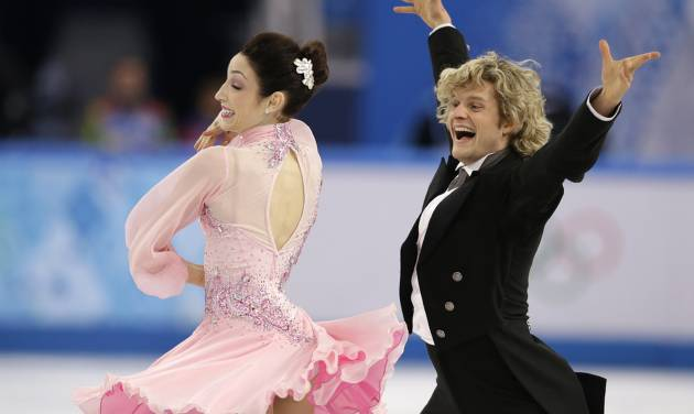Meryl Davis and Charlie White of the United States compete in the ice dance short dance figure skating competition at the Iceberg Skating Palace during the 2014 Winter Olympics, Sunday, Feb. 16, 2014, in Sochi, Russia. (AP Photo/Darron Cummings)
