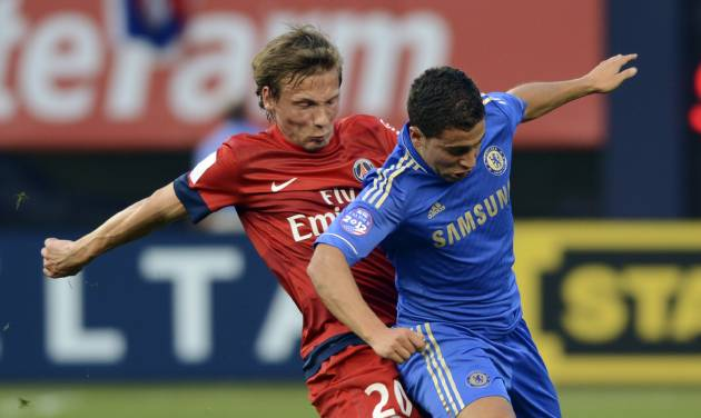 Chelsea FC's Eden Hazard, right, and Paris Saint-Germain's Clement Chantome compete for the ball during the first half of their exhibition soccer match at Yankee Stadium in New York, Sunday, July 22, 2012. (AP Photo/Henny Ray Abrams)