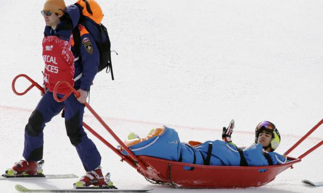 Andorra's Joan Verdu Sanchez is carried away by medics after he crashed in the first run of the men's giant slalom at the Sochi 2014 Winter Olympics, Wednesday, Feb. 19, 2014, in Krasnaya Polyana, Russia. (AP Photo/Gero Breloer)