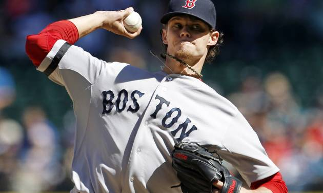 Boston Red Sox starting pitcher Clay Buchholz throws against the Seattle Mariners in the third inning of a baseball game, Monday, Sept. 3, 2012, in Seattle. (AP Photo/Elaine Thompson)