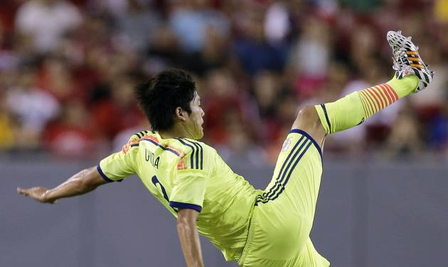Japan defender Atsuto Uchida flies through the air after getting upended going up for a header by Costa Rica midfielder Celso Borges, left, during the first half of a friendly soccer match, Monday, June 2, 2014, in Tampa, Fla. (AP Photo/Chris O'Meara)