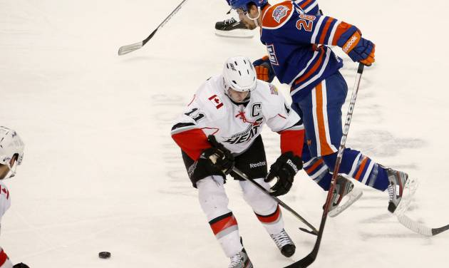Mark Arcobello with the Oklahoma City Barons goes past Quintin Laing of the Abbotsford Heat during an AHL hockey game at the Cox Convention Center in Oklahoma City, Friday, April 19, 2013. Photo by Bryan Terry, The Oklahoman