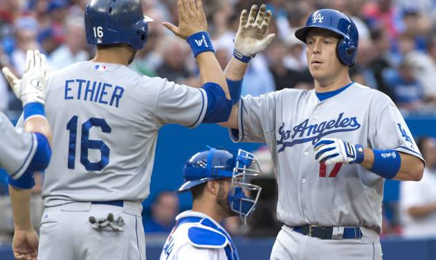 Los Angeles Dodgers A.J. Ellis celebrates his two-run homerun with teammate Andre Ethier as Toronto Blue Jays catcher J.P. Arencibia looks on during the second inning against the Toronto Blue Jays  in Toronto on Monday July 22, 2013. (AP Photo/The Canadian Press, Frank Gunn)