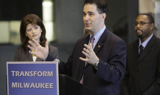 """Gov. Scott Walker makes a Milwaukee economic development announcement at the Hatco Corporation Storage Warehouse on South 28th Street in Milwaukee on Monday, April 30, 2012. Joining the governor are Lt. Gov. Rebecca Kleefisch and Workforce Development Director Reggie Newson. Walker announced the $100 million """"Transform Milwaukee"""" initiative Monday that he said is intended to draw businesses to Wisconsin's largest city by fixing up blighted areas and providing economic incentives. (AP Photo/Milwaukee Journal-Sentinel, Mike De Sisti)"""