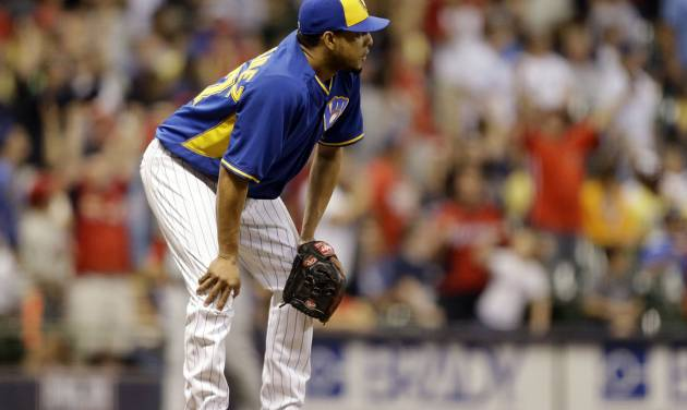 Milwaukee Brewers' Francisco Rodriguez watches the home run by St. Louis Cardinals' Matt Holliday during the ninth inning of a baseball game Friday, July 11, 2014, in Milwaukee. (AP Photo/Jeffrey Phelps)