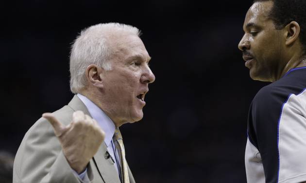 San Antonio Spurs coach Gregg Popovich, left, argues a call during the first quarter of Game 1 of the opening-round NBA basketball playoff series against the Dallas Mavericks, Sunday, April 20, 2014, in San Antonio. (AP Photo/Eric Gay)