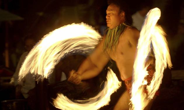 """FILE - This Feb. 3, 2005 file photo shows Vise Vitale of Honolulu performing a Samoanfireknifedanceduring in an """"Aloha Friday"""" celebration of Polynesian music song anddancein Honolulu. Fire knife dancing is often mistaken for Hawaiian even though it's a Samoan invention. Hawaii resorts are increasingly turning to Hawaii's actual rich traditions to make trips special for travelers. (AP Photo/Lucy Pemoni, file)"""