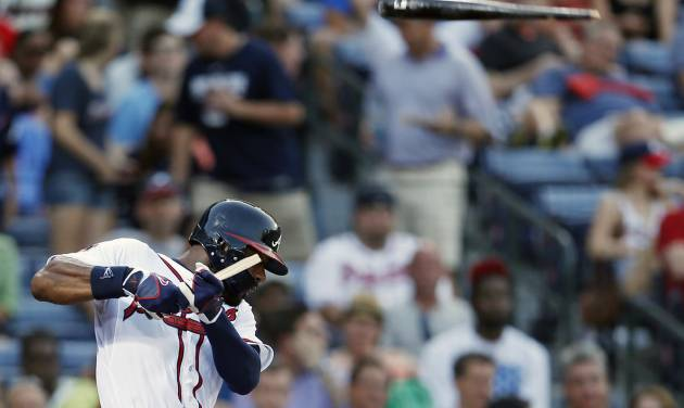 Atlanta Braves' Jason Heyward (22) breaks his bat as he fouls off a pitch in the third inning of a baseball game against the New York Mets in Atlanta, Tuesday, July 1, 2014. The bat sailed into the crowd but no one was injured. (AP Photo/John Bazemore)