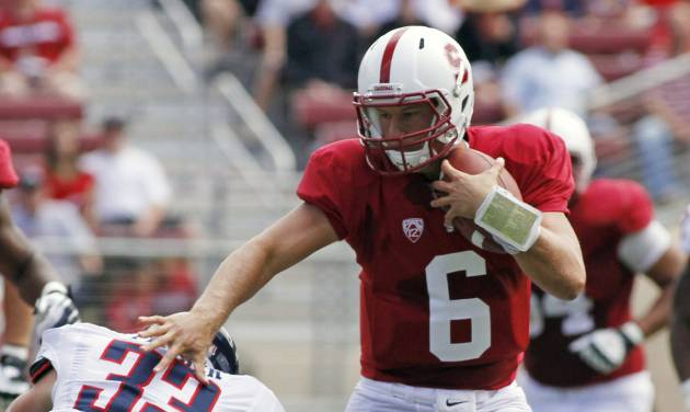 Stanford quarterback Josh Nunes runs with the ball past Arizona's Jake Fischer during the first half of an NCAA college football game in Stanford, Calif., Saturday, Oct. 6, 2012. (AP Photo/George Nikitin)