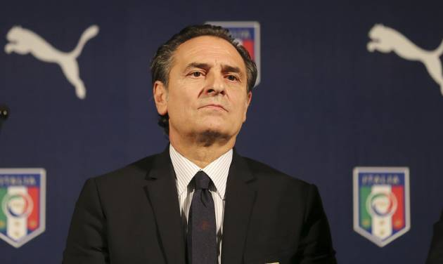 Italy coach Cesare Prandelli listens to reporters' questions during a press conference for the presentation of the new Italy soccer team jersey, in Milan, Italy, Monday, March 3, 2014.  Mario Balotelli is out injured and Daniele De Rossi has been dropped due to a code of ethics violation for Italy's friendly at World Cup holder Spain on Wednesday. Missing two key starters, coach Cesare Prandelli gave Torino forward Ciro Immobile and Parma defender Gabriel Paletta their first call ups to Italy's squad on Sunday. (AP Photo/Antonio Calanni)