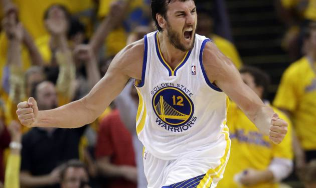 Golden State Warriors' Andrew Bogut celebrates after scoring against the Denver Nuggets during the second half of Game 6 in a first-round NBA basketball playoff series in Oakland, Calif., Thursday, May 2, 2013. Golden State won 92-88. (AP Photo/Marcio Jose Sanchez)