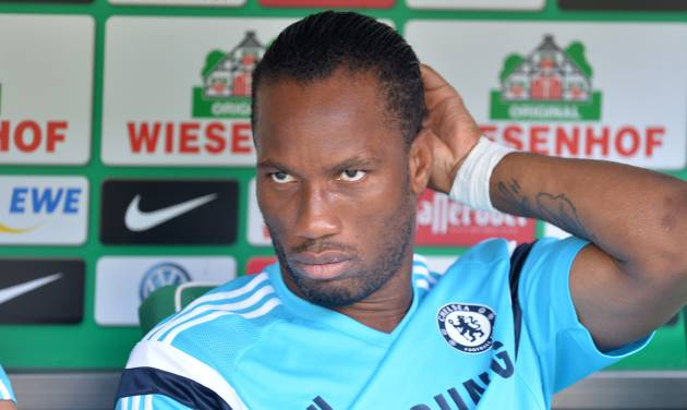 Chelsea's  Didier Drogba sits on the bench prior to the preseason soccer match between SV Werder Bremen and FC Chelsea, in Bremen, northern Germany, Sunday Aug. 3, 2014.   (AP Photo/dpa, Carmen Jaspersen)