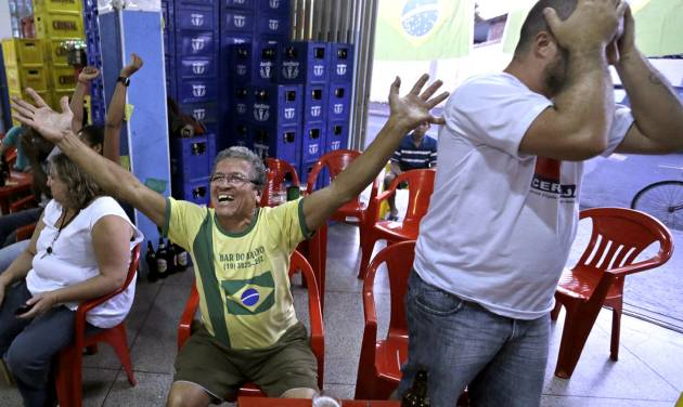 Brazil supporters react as they watch on the television the group A World Cup soccer match between Brazil and Mexico, at a bar in Indaiatuba, Brazil, Tuesday, June 17, 2014.(AP Photo/Shuji Kajiyama)